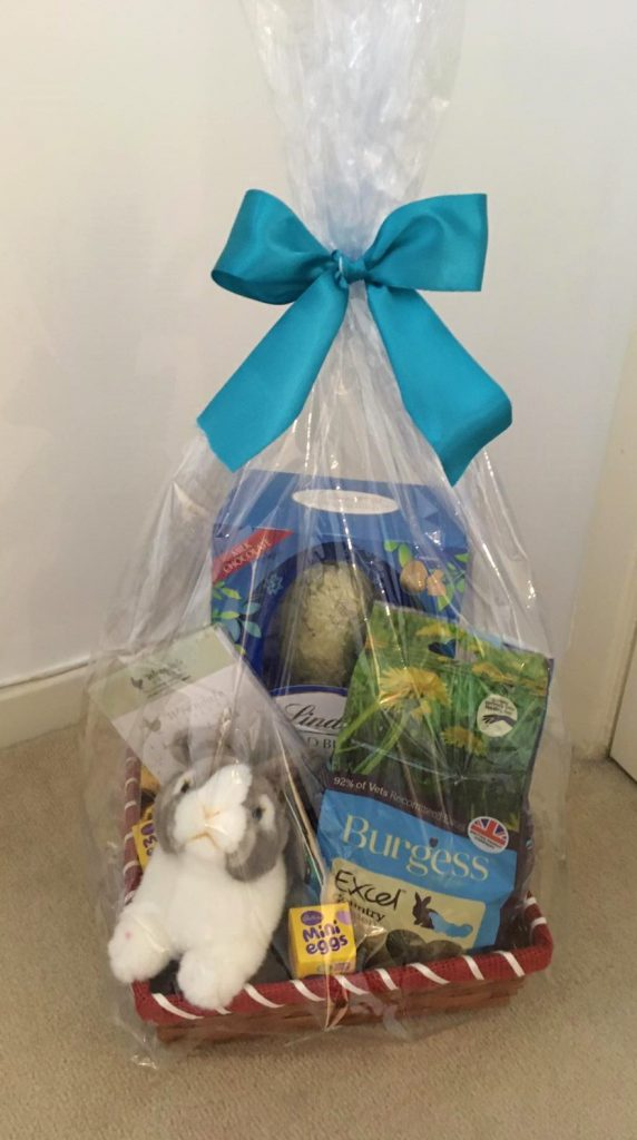 Picture of a hamper containing a toy rabbit, an easter egg and other bunny elated prizes.